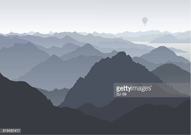 Mountains landscape, birds eye view, balloon in the background