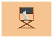 simple icon of a movie director chair