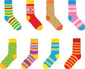 Collection of multi-colored socks with patterns and stripes