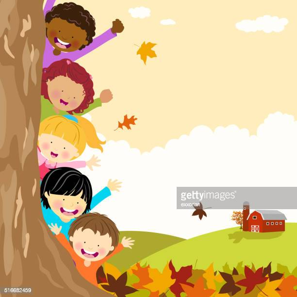 Multi-Ethnic Kids Hiding Behind Tree at Autumn