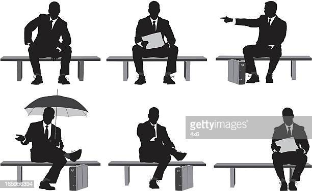 Multiple images of businessman sitting on a bench