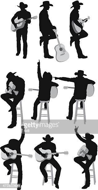 Multiple silhouettes of guitarist
