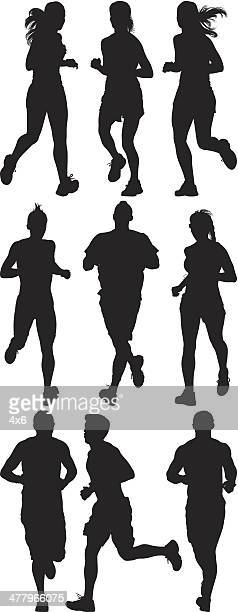 Multiple silhouettes of people running