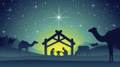 A nice Christmas Nativity Background with Jesus Christ, Mary and Joseph in a manger at night. Surrounded by cows and camels and a city on a hill in the background.