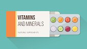 Slices of vegetables and fruit in a drug blister packaging and open box, natural supplements and vitamins concept
