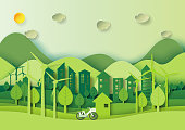 Save the world and environment concept.Eco green city and urban landscape for green energy paper art style.Vector illustration.