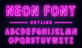 Neon alphabet with numbers. Purple neon font, fluorescent lamps on brick wall background, outline style font. Vector