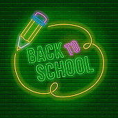 Back to school neon glowing emblem against a brick wall background. Vector illustration.