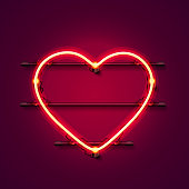 Neon heart signboard on the red background. Vector illustration