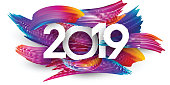 White 2019 new year background with spectrum brush strokes. Colorful gradient brush design. Greeting card or poster template. Vector paper illustration.