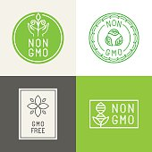 Vector set of design elements and badges for food and cosmetics packaging - non gmo and gmo free - natural ingridients labels and emblems