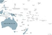 Oceania political map with countries. English labeling. Region, comprising Australia and the Pacific islands with the regions Melanesia, Micronesia and Polynesia. Gray illustration over white. Vector.
