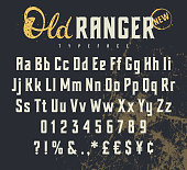 Vintage vector alphabet in the western style. Wild West font. Uppercase, lowercase letters and numbers. Grunge background on a separate layer