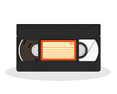 Old video cassette isolated on a white background. Retro style movie storage icon. Vintage record video recorder tape. Vector illustration.