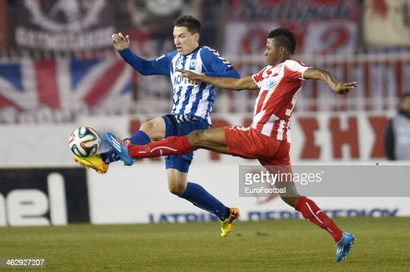 Olympiakos' Micheal Olaitan fights for the ball with Sebastian Garcia of Atromitos Athens during the Greek Superleague match between Atromitos...
