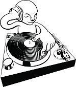 A cartoon alien character DJ on turntable decks