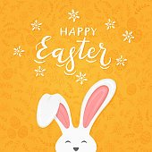 Cute Easter rabbit with ears and lettering Happy Easter on orange background with floral elements and eggs, illustration.