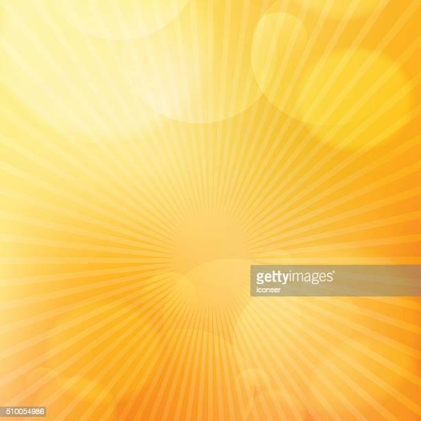 Naranja brillante fondo con rayos de luz incandescente