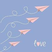 Origami paper plane set . Dash line loop in the sky. Word Love. Greeting card. Flat design. Serenity, pink rose quartz color. Vector illustration