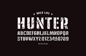 Original stencil-plate sans serif font. Bold face. Letters and numbers with rough texture for label and emblem design. White print on black background