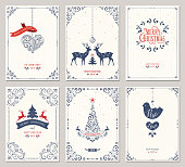 Ornate vertical winter holidays greeting cards with New Year tree, reindeers, Christmas ornaments, dove, swirl frames and typographic design. Vector illustration.