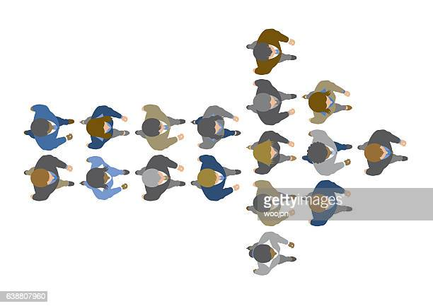 Overhead view of business leader bringing his team to success