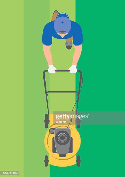 Overhead view of man mowing lawn