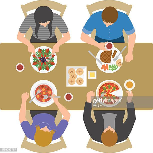 Overhead view of people having lunch and talking at restaurant