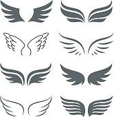 Pair of monochrome wings vector icon set. The concept of freedom or flight. Abstract silhouettes of wings isolated on white background.