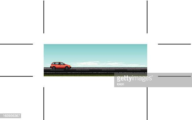 Panoramica strada e auto rossa