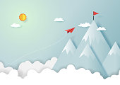 Paper airplanes flying to the top of mountains.Paper art style of start up and business vision creative concept idea.Vector illustration