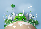 Eco-friendly car in the city. paper art and digital craft style.