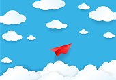 Paper cut of plane on blue sky with cloud and sun light