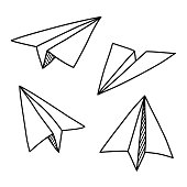 Doodle paper plane set in hand drawn sketch style. Isolated vector illustration.