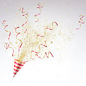 party popper with confetti on a light background