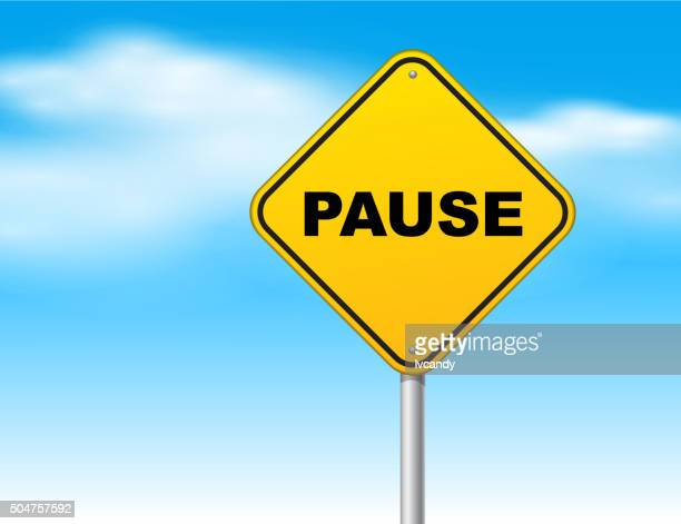Pause road sign