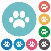 Paw prints flat white icons on round color backgrounds