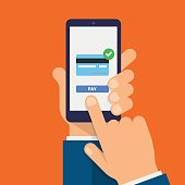 Payment page and credit card on smartphone screen. Hand holds the smartphone and finger touches screen. Modern Flat design illustration.