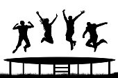 People jumping trampoline silhouette
