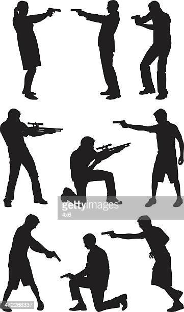 People pointing with firearms