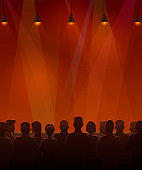 Vector illustration of silhouettes of audience sitting at the stage.