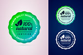 100 percents natural certified product round badge. The premium quality product. Vector badge in trendy gradient style in three color variants for eco, green, natural products.