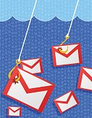 Phishing mail concept with an envelopes caught on a fishing hooks