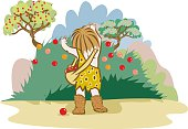 a stone age man picking red fruits