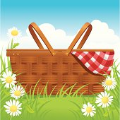 Picnic basket with napkin and daisies.