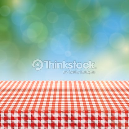 picnic table with red checkered pattern of linen tablecloth and