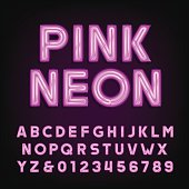 Pink neon tube alphabet font. Type letters and numbers on a dark background. Vector typeface for labels, titles, posters etc.
