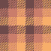 Pixel plaid tartan check pattern in brown, pink, and orange. Seamless check plaid for poncho, scarf, blanket, jacket, coat, or other textile design.