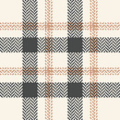 Plaid pattern seamless vector graphic. Tartan check plaid in grey and beige for scarf, poncho, or other fashion textile design. Herringbone woven pixel texture.
