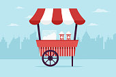 Popcorn cart in the city. Flat design style.